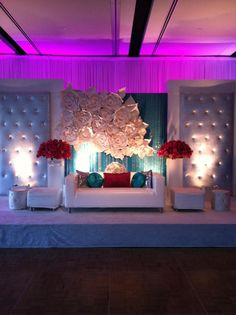 dislike the the floral set up the background. It reminds of furniture. The placing/look of those white rossets is a little tacky looking.