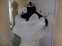 Using Getta Grip clips to hold the organza onto the boning for the cloud like elaborate neckline of a gown. Figuring it out as I go....