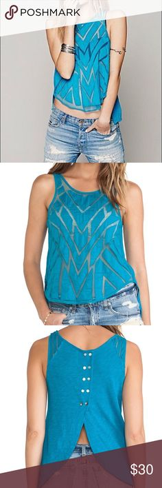 Free People Geometric Cut Out Top. Size Medium. Bright blue top with geometric shapes and partially sheer front. Tulip back. Edges of geometric shapes a little worn, but that is how it was sold / supposed to look. Only worn a hand full of times. Free People Tops Tank Tops