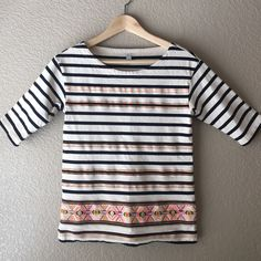 """J Crew tribal embroidered top J. Crew. Size XXS. Navy and off white Striped knit top. Half sleeves. Tribal Aztec inspired exposed embroidery in bright thread. Such a cute summer top. Length 22.5"""", bust 15.25"""" across lying flat. 100% cotton. Excellent condition. J. Crew Tops"""