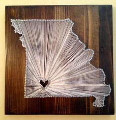One of the first custom string art pieces I made that wasn't TX... Gotta branch out sometime!  <3 Kaitlin   (Owner of DownSouthInTexas)