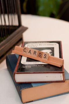 Scrabble wedding theme - scrabble tiles and holders used as place cards or table markers