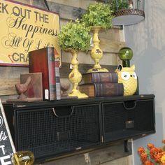 Rodworks - Black Two Drawer Shelf, wall shelf, metal shelf, shelf with drawers, home decor, yellow candle sticks, candle sticks, candle holders, bookends, bird decor