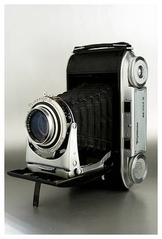 """Voigtländer Bessa II: Self folding camera with a coupled rangefinder. he Bessa is a medium format folder that uses 120 Film to produce 6x9"""" photographs. 34,500 Bessa II's made from 1950 to 1956. The Bessas II were fitted with a Color-Skopar 3.5/10.5 cm, or a Color-Heliar 3.5/10.,5 cm or from 1954, the rare and sought-after Apo-Lanthar 4.5/10.5 cm. The Compur-Rapid shutter fitted on the earlier models was replaced by the Synchro-Compur shutter from 1951. The accessory shoe appears only from…"""