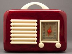 Radio by General Television, model 591 with marbleized Catalin red body that's offset by ivory-toned Tenite trim.