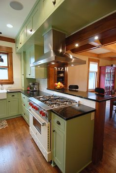 A beautiful cream Bluestar range takes center stage in this Vail kitchen.