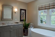 Grey vanity with a bit of a brown hue, warm wall colors.  Black and white accents.