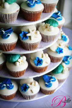 Simple beach-themed wedding cupcake tower display #weddingcupcakes #cupcakes #wedding #cupcaketower #beachwedding