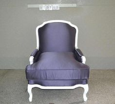 Custom armchair with white frame and fabric upholstery.