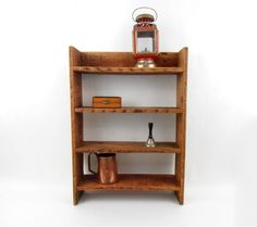 $59.00 - Add a touch of country charm to your home with our rustic wood shelving unit. Handcrafted from heat treated pallet wood, stained and sealed with Danish oil, this shelf is perfect for those little mementos, collectibles, or photographs...Click on the image above for more information or to buy from WileWood. Thank you for your interest!