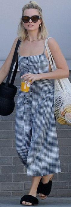 deb4f4dc4a46 Who made Margot Robbie s black slide sandals