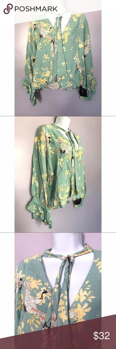{Zara} Tie Neck Ruffle Sleeve Blouse Fun & bright bird and floral pattern. Tie neck with ruffle sleeves. Location: CM3 Zara Tops