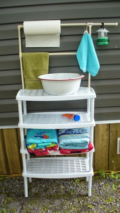 Campy Canadians: Outdoor Camping Wash Stand -- Those shelves are a great idea for inside the tent for the towels and shower house stuff.