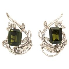 Emerald Cut Green Tourmaline Diamond Gold Earrings | From a unique collection of vintage clip-on earrings at https://www.1stdibs.com/jewelry/earrings/clip-on-earrings/