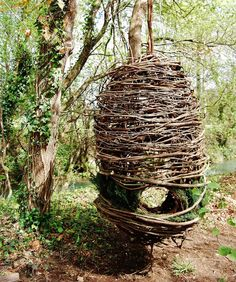 This cocoon suspended from a tree in woodlands of Arcozelo, in northern Portugal, was part of Art Nature Fest which was held in March 2013. It is the work of Jaime Filipe, an inspiring land artist who has been creating beautiful natural art in Portugal for some seven years. More at www.naturalhomes.org