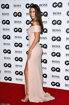 Simply stylish:The creation featured a racy thigh-high split which flaunted her endless legs, lengthened further with a pair of nude satin barely there heels