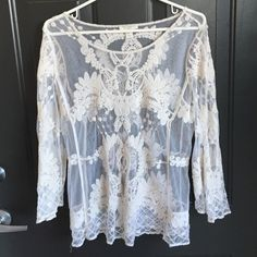 Sheer designed white top . Tops