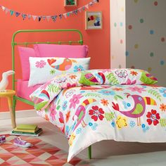 Toucan is a bright and colourful design featuring birds, flowers and ferns on a white background. A delightful print for the young ones that features the same print on the reverse. The quilt cover has press stud closure.