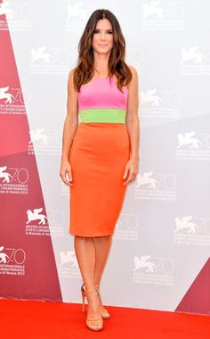 Sandra Bullock's sherbert-colored stripes match her bright personality in this Alex Perry dress. #fashion