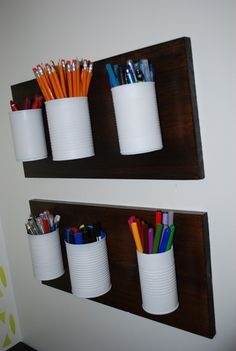 Recycle cans mount them to a piece of wood for cool storage. Great for recycling baby formula cans too. Gives the option for storing large things. Art stuff, garage or basement. (Liv's crayons??)