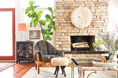 A vintage lounge chair covered in on-trend mudcloth injects an eclectic flair into the living room's neutral design.