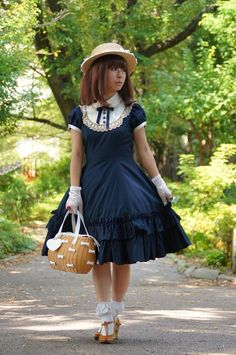 Harijuku, Tokyo: Oh laws. I saw a lot of young women in crazy little girls outfits like this in the area. Some with parasols and teddy bears. Truly weird.