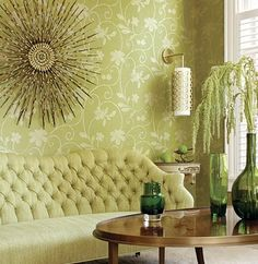 Monochromatic yellow/green room, love the tufted sofa. Love the calm, soothing colour scheme. Very restful.