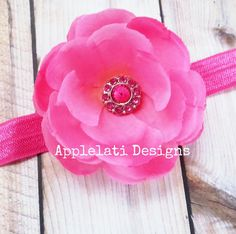 Girls pink flower hair clip with headband.     This flower is attached to a lined alligator clip and measures approximately 3.5 in wide.     The flower clips on to the headband and can be worn by itself, in the hair, or with the headband.     The headband is also interchangeable and can be used w...