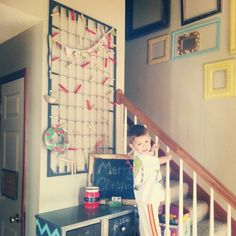 What a great idea to hang Christmas cards. A crib mattress spring.