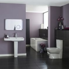 We like how Hudson Reed have used purple walls to display this Granger Bathroom Suite.