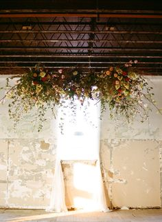 a window dressed up with a floral spray and sheers /  Photography by austin gros / via; style me pretty