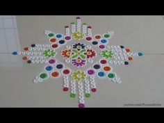 Easy multicolored rangoli design using betel nut   Innovative rangoli de...