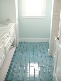 Love the colored floor tiles and coordinating wall color - idea for my rental house bathrooms! - Fox Home Design Style At Home, Beach Bathrooms, Coastal Bathrooms, Blue Bathrooms, Beach House Decor, Home Decor, Beach Condo, Beach Cottages, Beach Houses