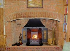 Dovre 2000 wood burning fireplace installed into this old Essex inglenook, Little Waltham by Scarlett Fireplaces 1998