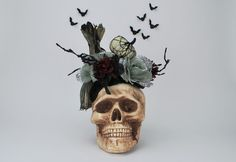 This Gothic Skull Halloween Bouquet is Wicked! It's Dungeon-Inspired theme is going to be a sure conversation piece at your Haunted House this year! This is great for your Halloween Home Decor, your H