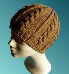 Caramel Cable Hat  The thick cables on this hat will keep your ears extra warm during cold winter days. The hat is knit at a fairly tight gauge, so please check the notes about gauge and size in order to get the right length.