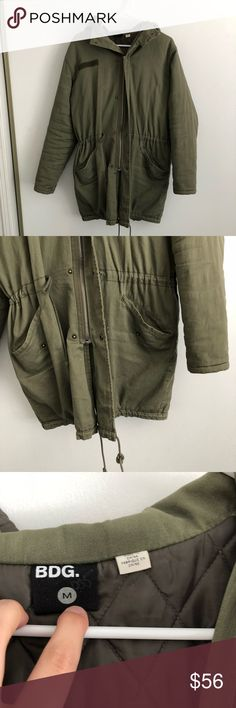 BDG winter coat BDG army green winter coat. Only flaw is in one pocket the liner has a hole. Other then that awesome condition. Quilted inside so keeps you very warm! And also very stylish! BDG Jackets & Coats