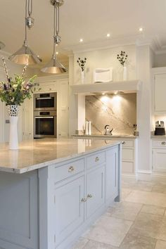 Gray Kitchen Floor Aid Creamy White Cabinets Paired With Supreme Quartzite Why Not Have A Gorgeous Island As The Centerpieces Of Your If You Can Since Is Heart Home Add Another Place For Family