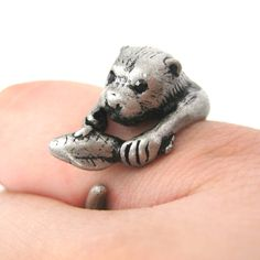 A realistic animal ring made in the shape of an otter with a fish in its paw in silver! It is very detailed and super cute! Perfect gift for any animal lover!