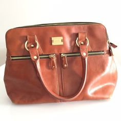 """Modalu 'Pippa' Handbag Handbag from Modalu in London. Classic Pippa style in dark tan leather with gold tone hardware and iconic shell fabric lining. Top of handles to top of bag is 6"""". Bag is 14"""" wide, 10"""" tall and 5"""" deep. Lightly used; in great condition. Same as Pippa Middleton carries! Modalu Bags Shoulder Bags"""