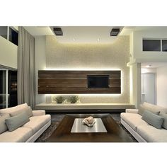 The TV panel!  #interior #design #decor #interiordesign #instahome #instadesign #instadecor #instahomes #instagood #webstagram #style #home #villa #apartment #tv #panel #lighting #idea #cove #light #wood #wooden #livingroom #family #hall #modern #theme #style #Padgram