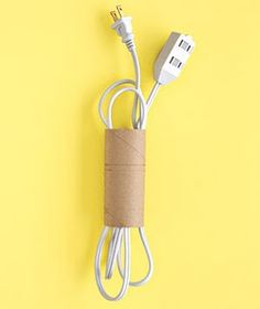 Cardboard toilet paper roll for storing cords. Clever, clever.