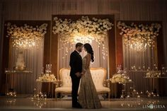 Ivory flowers in a gold frame for reception maharani wedding stage backdrop deco. Wedding Ceremony Ideas, Wedding Stage Design, Wedding Reception Backdrop, Wedding Stage Decorations, Wedding Mandap, Wedding Designs, Wedding Table, Wedding Cakes, Hotel Wedding