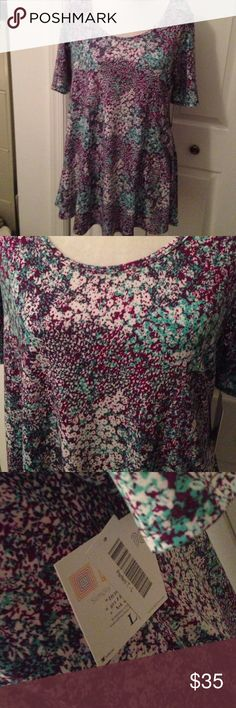 LuLaRoe perfect T large NWT LuLaRoe perfect T large new with tags. Purple green and white flower design. LuLaRoe Tops Tees - Short Sleeve