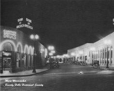 """A very """"Noir"""" photo of Little Santa Monica Blvd. facing West from Canon Dr. c.1930's.    Photo Credit: Marc Wanamaker/Bison Archives via Beverly Hills Historical Society"""