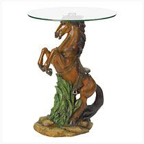 """Incredibly lifelike and astonishingly beautiful, this figural accent table is sure to be the focus piece of your decor. A noble stallion is captured in action, eyes flashing and mane flowing as he stands proudly upon his mighty hind legs. Lovingly rendered in every detail, from head to hoof, from saddle to reins. Polystone base; glass top.       May require additional freight charge. 19"""" diameter x 24 3/8"""" high.              Item:  38426    Price: $139.95  My Price: $69.98 (50% off)"""