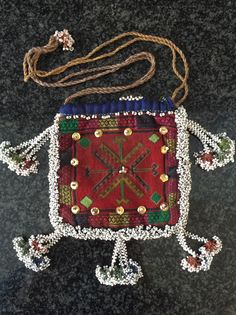 Another  beautiful antique silk embroidered and glass bead woven Central Asian bag from Nuristan region of Afghanistan. Ethnographic arts of Nuristan (be it textiles or wood artefacts) are very distinct in  ...