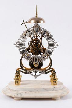 A Victorian passing strike skeleton clock (c. 1860London)
