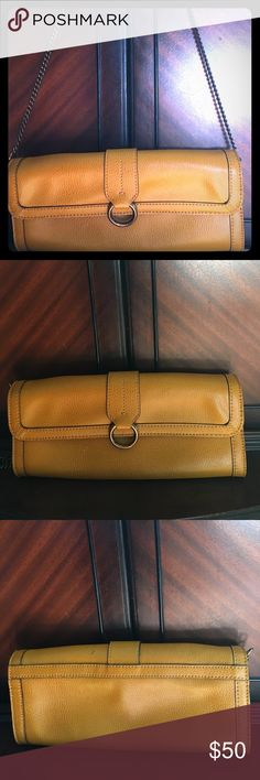 Banana republic clutch purse Absolutely gorgeous Banana Republic clutch purse. Mustard yellow color. Excellent condition. Would go perfectly dressed up or dressed down. Banana Republic Bags Travel Bags