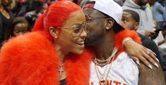 """Gucci Mane Girlfriend Hair  Gucci Mane's girlfriend's hair looked stunning on Tuesday night at the Atlanta Hawks game. Instead of the pink she's been seen in lately Keyshia Ka'oir's hair was red. The color was perfect for the occasion. Gucci Mane proposed to Keyshia during the game. Guwop is settling down: """"I think I love her!""""  The Atlanta rapper surprised Ka'oir with a 25-carat diamond engagement ring. Keyshia's next hair color will have to be platinum to match her new rock! If there's one…"""